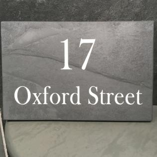 Street sign for a house engraved in slate