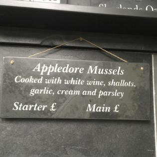 Shop products and prices on an engraved slate sign