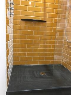 Brick surround and glass front to our slate shower tray