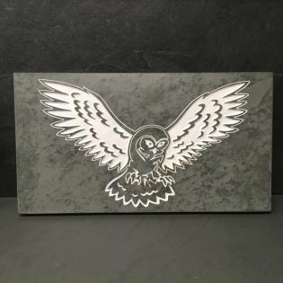 owl engraved onto slate