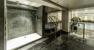 hot tub and shower with slate tiles and skirting boards