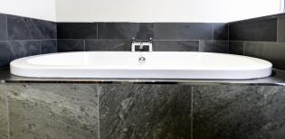 sunken bath with slate surrounds