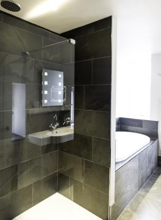 modern bathroom with slate wall tiles
