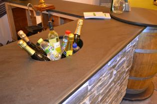 oval wine bottle holder in a slate bar worktop custom made