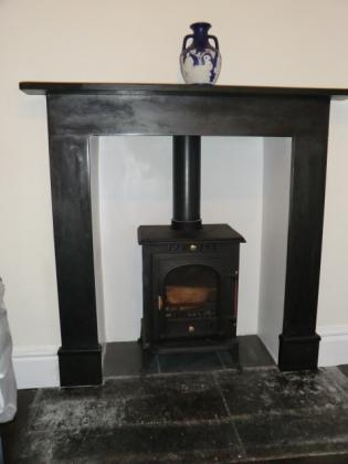 Square wooden framed woodburner with slate hearth